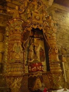 Retablo do Santo Cristo da igrexa de San Miguel de Pexegueiro